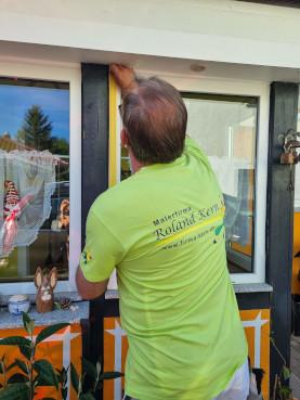 Malermeister Kern bei der Arbeit mit Gosda Berufsbekleidung